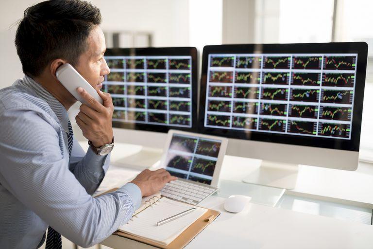 man trading at computer