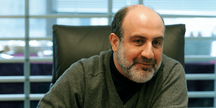 Photo showing Nassim Taleb sitting at desk.